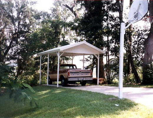Free standing white carport with pickup truck under it