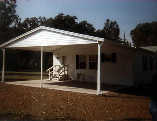 White aluminum carport attached to mobile home