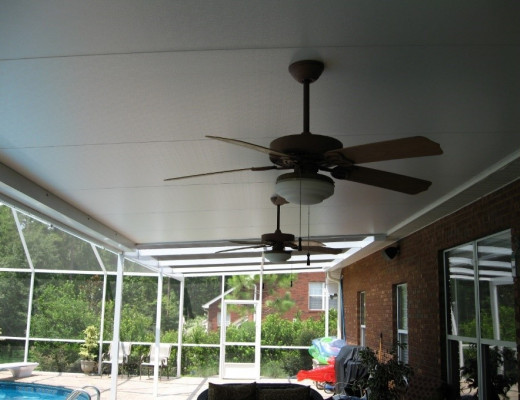 An insulated panel roof with ceiling fans