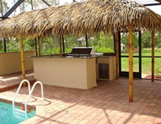 Tiki patio cooking area by pool