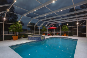 Nebula lighting in screen pool enclosure at dusk
