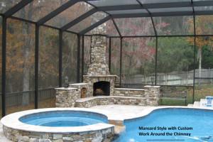 Screen pool enclosure custom built around rock chimney