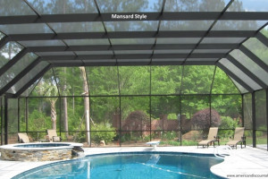 Mansard style screen pool enclosure with diving board and lawn chairs