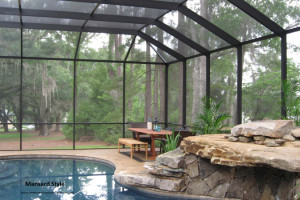 Mansard style screen pool enclosure with patio set