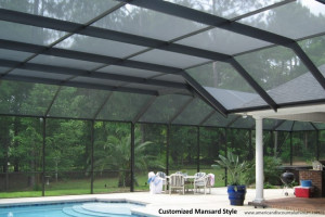Multi dimensional mansard style screen pool enclosure with plant and patio set