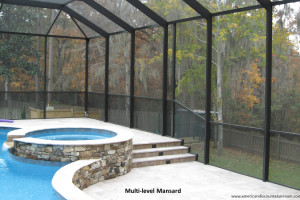 Multi level mansard style pool enclosure with rock hot tub
