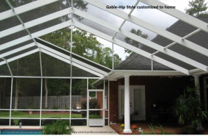 Gable hip style screen pool enclosure attached to brick home