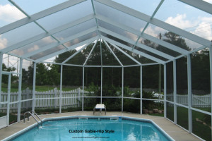 Custom gable hip style screen pool enclosure with diving board