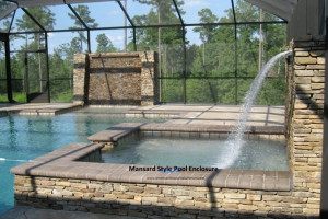 Mansard style screen pool enclosure with rock waterfall