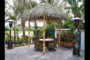 Tiki hut on patio by water