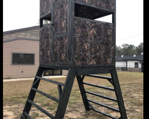 Camouflage deer stand standing about 12 feet tall