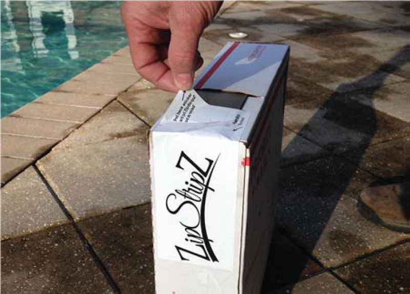 Box of ZipStipZ on a patio by a pool